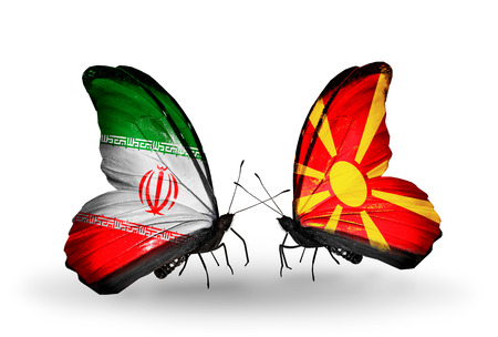 Two butterflies with flags on wings as symbol of relations Iran and Macedonia photo