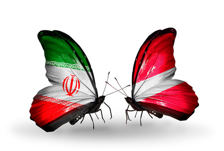 Two butterflies with flags on wings as symbol of relations Iran and Latvia photo