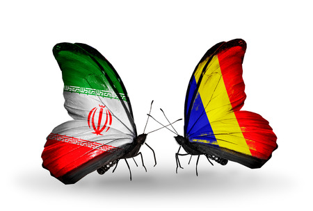 Two butterflies with flags on wings as symbol of relations Iran and Chad, Romania photo