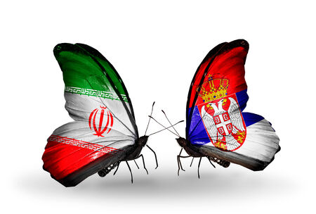 Two butterflies with flags on wings as symbol of relations Iran and Serbia photo