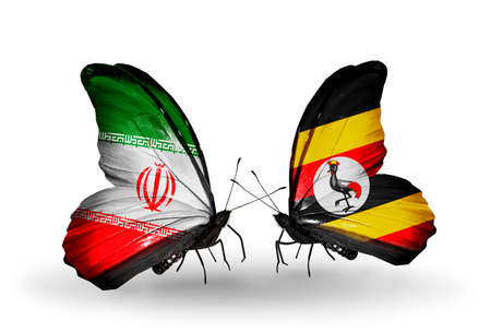 Two butterflies with flags on wings as symbol of relations Iran and Uganda photo