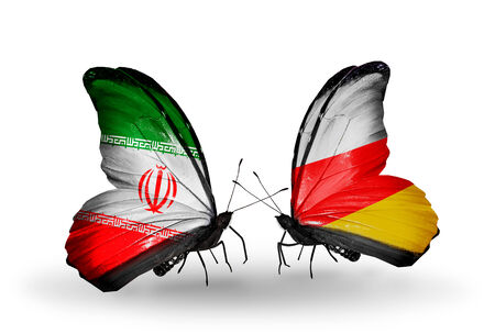 Two butterflies with flags on wings as symbol of relations Iran and South Ossetia photo