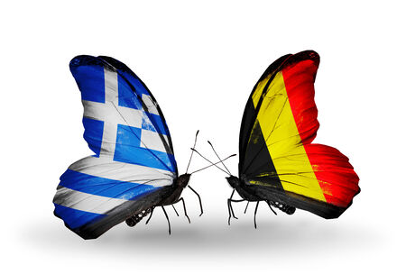 Two butterflies with flags on wings as symbol of relations Greece and Belgium photo