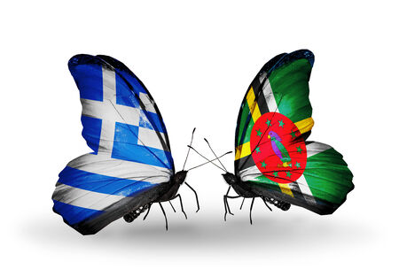 Two butterflies with flags on wings as symbol of relations Greece and Dominica photo