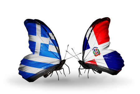 Two butterflies with flags on wings as symbol of relations Greece and Dominicana photo