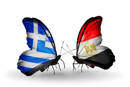 Two butterflies with flags on wings as symbol of relations Greece and Egypt photo