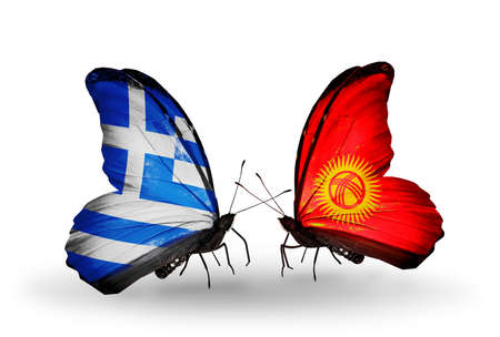 Two butterflies with flags on wings as symbol of relations Greece and Kirghiz photo