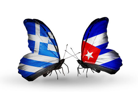 Two butterflies with flags on wings as symbol of relations Greece and Cuba Stock Photo