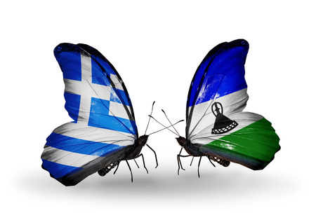 Two butterflies with flags on wings as symbol of relations Greece and Lesotho photo