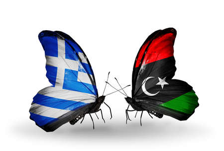 Two butterflies with flags on wings as symbol of relations Greece and Libya photo