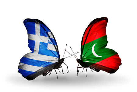Two butterflies with flags on wings as symbol of relations Greece and Maldives photo