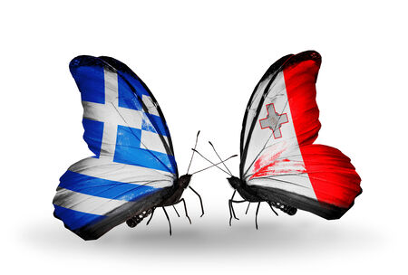 Two butterflies with flags on wings as symbol of relations Greece and Malta photo