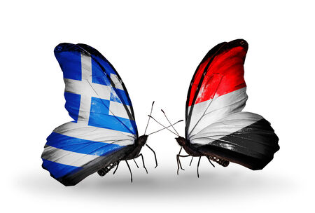 Two butterflies with flags on wings as symbol of relations Greece and Yemen photo