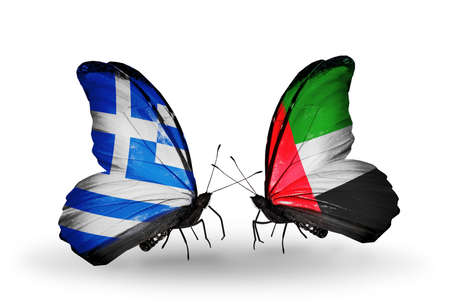 Two butterflies with flags on wings as symbol of relations Greece and United Arab Emirates photo