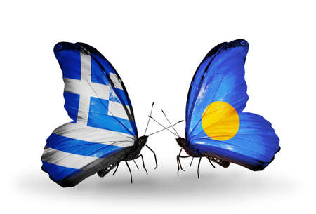 Two butterflies with flags on wings as symbol of relations Greece and Palau photo