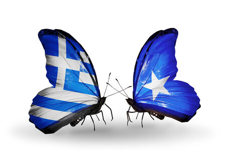 Two butterflies with flags on wings as symbol of relations Greece and Somalia photo