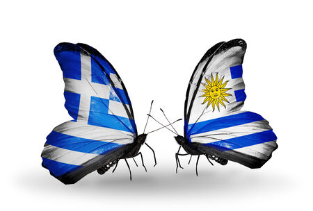 Two butterflies with flags on wings as symbol of relations Greece and Uruguay photo