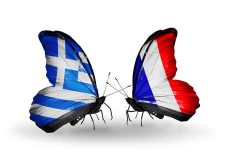 Two butterflies with flags on wings as symbol of relations Greece and France photo