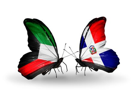 Two butterflies with flags on wings as symbol of relations Kuwait and Dominicana photo