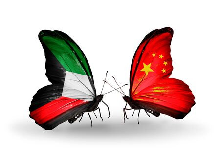Two butterflies with flags on wings as symbol of relations Kuwait and China photo