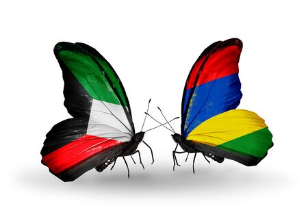 Two butterflies with flags on wings as symbol of relations Kuwait and Mauritius photo
