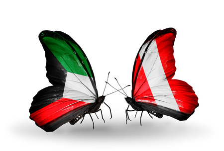 Two butterflies with flags on wings as symbol of relations Kuwait and Peru photo