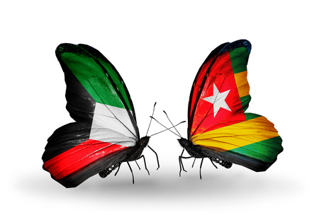 Two butterflies with flags on wings as symbol of relations Kuwait and Togo photo