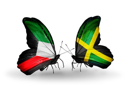 Two butterflies with flags on wings as symbol of relations Kuwait and Jamaica photo