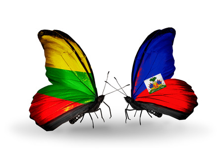 Two butterflies with flags on wings as symbol of relations Lithuania and  Haiti photo