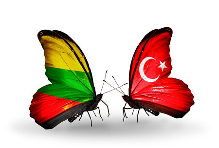 Two butterflies with flags on wings as symbol of relations Lithuania and Turkey photo