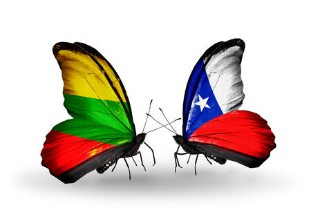 Two butterflies with flags on wings as symbol of relations Lithuania and Chile photo