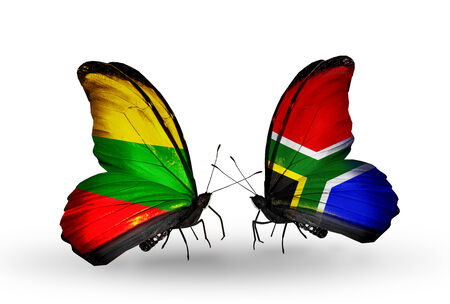 Two butterflies with flags on wings as symbol of relations Lithuania and South Africa photo