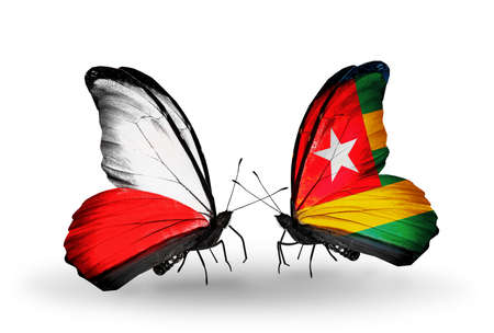 Two butterflies with flags on wings as symbol of relations Poland and Togo photo