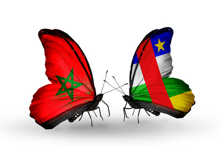 african solidarity: Two butterflies with flags on wings as symbol of relations Morocco and Central African Republic Stock Photo