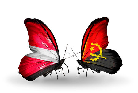 Two butterflies with flags on wings as symbol of relations Latvia and Angola photo