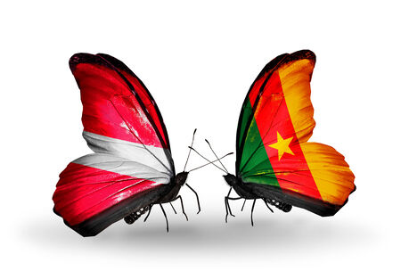 Two butterflies with flags on wings as symbol of relations Latvia and  Cameroon photo