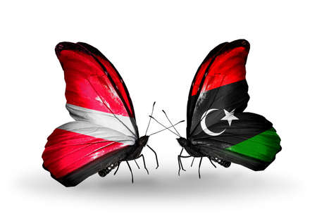Two butterflies with flags on wings as symbol of relations Latvia and Libya photo