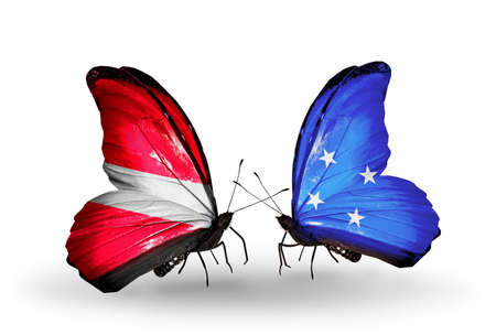 Two butterflies with flags on wings as symbol of relations Latvia and Micronesia photo