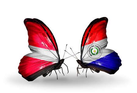 Two butterflies with flags on wings as symbol of relations Latvia and Paraguay photo