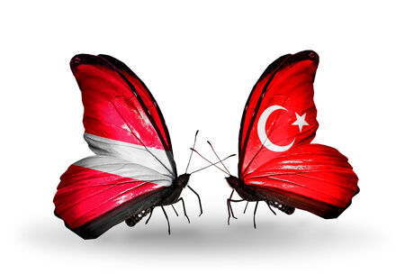 Two butterflies with flags on wings as symbol of relations Latvia and Turkey photo