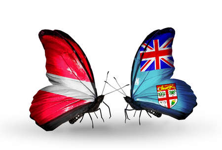 Two butterflies with flags on wings as symbol of relations Latvia and Fiji photo