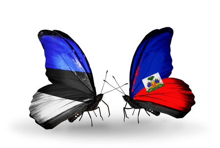 Two butterflies with flags on wings as symbol of relations Estonia and Haiti photo