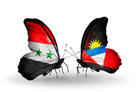 Two butterflies with flags on wings as symbol of relations Syria and Antigua and Barbuda photo