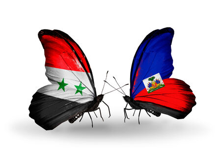 Two butterflies with flags on wings as symbol of relations Syria and  Haiti photo