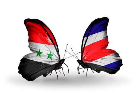Two butterflies with flags on wings as symbol of relations Syria and Costa Rica photo