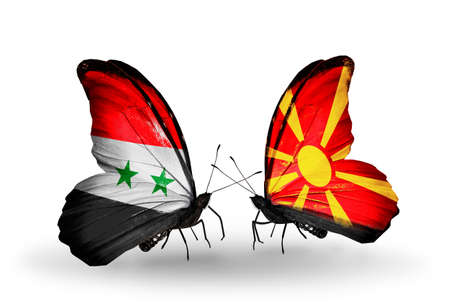 Two butterflies with flags on wings as symbol of relations Syria and Macedonia photo