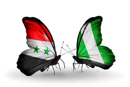 Two butterflies with flags on wings as symbol of relations Syria and Nigeria photo