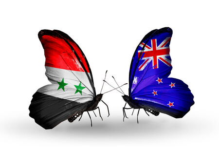 Two butterflies with flags on wings as symbol of relations Syria and New Zealand photo