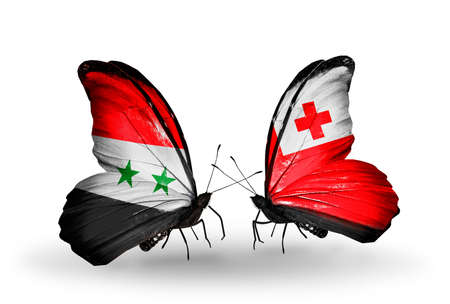 Two butterflies with flags on wings as symbol of relations Syria and Tonga Stock Photo