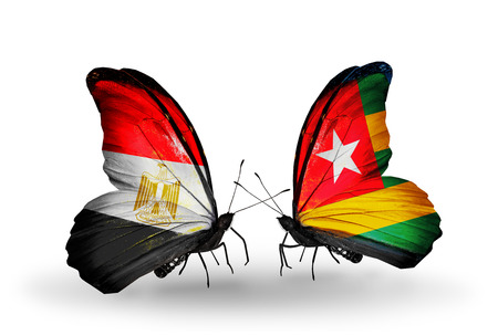 Two butterflies with flags on wings as symbol of relations Egypt and Togo photo